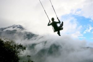 dramatic swing ride in baños in ecuador